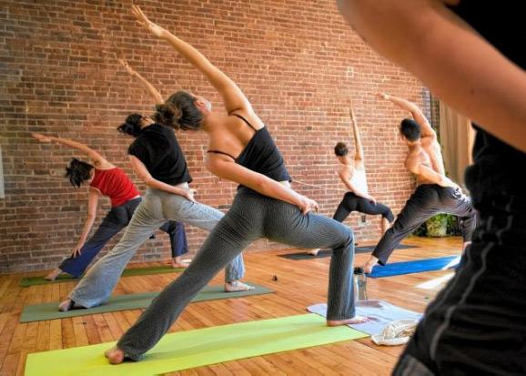 Reverse Warrior Pose in 8 Petals Yoga Class Bellingham